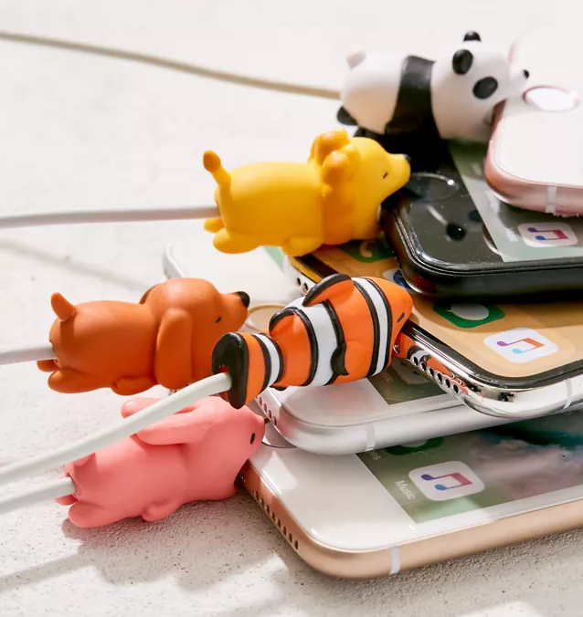 A ton of silicone animals attached to phone charging cables