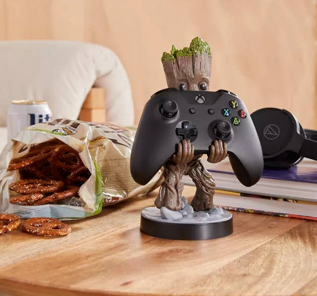 A small action figure holding an Xbox controller
