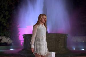 Cher standing in front of a fountain in Clueless