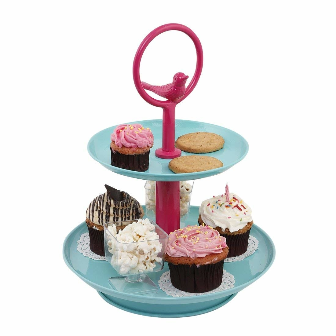 A two-tier blue and pink dessert stand with a pink decorative bird on top of the stand