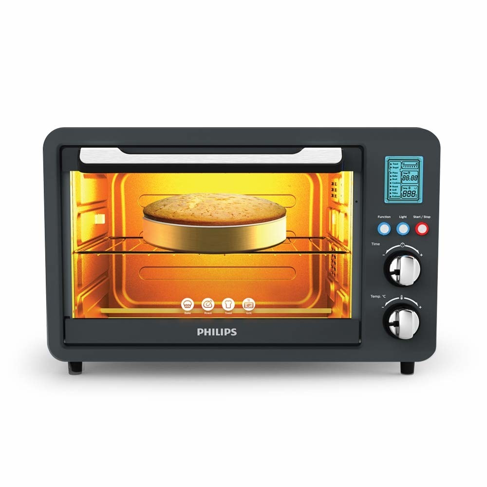 A digital oven toaster grill with a cake baking inside it