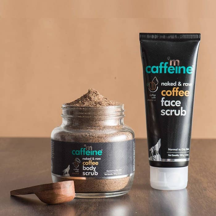mCaffeine coffee body scrub and face scrub with a wooden measuring spoon