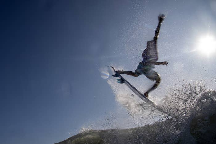 Italo surfing in midair, arms raised