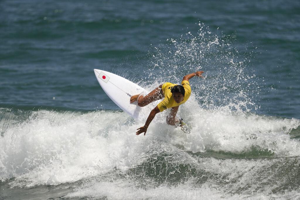 Mahina riding a crashing wave