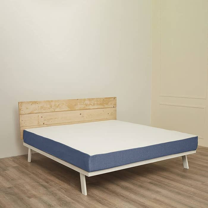 A bed with the mattress on it