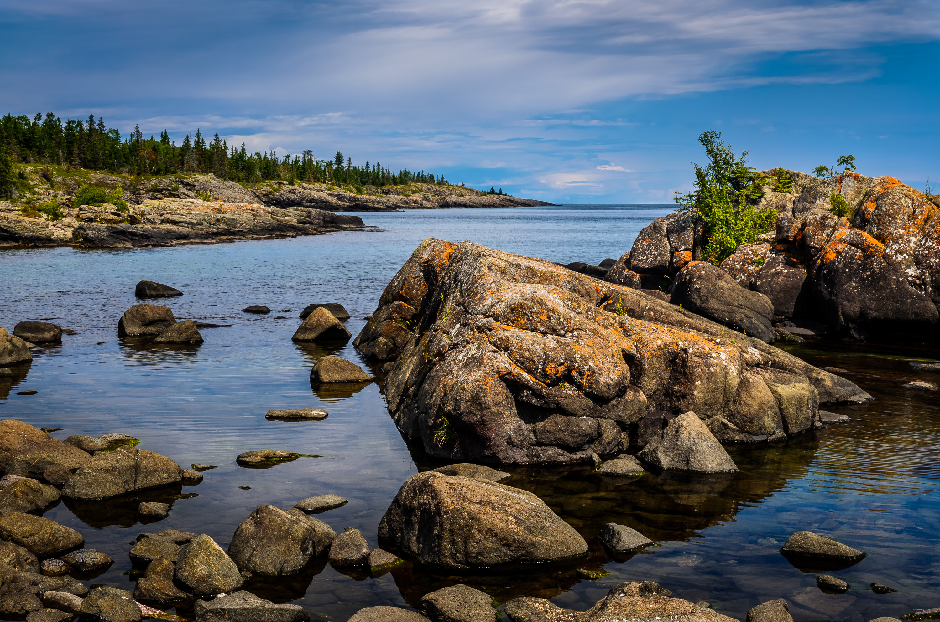 Coastal areas of Isle Royale were once submerged beneath prehistoric lake waters, and contain many tumbled boulders and other large rocks