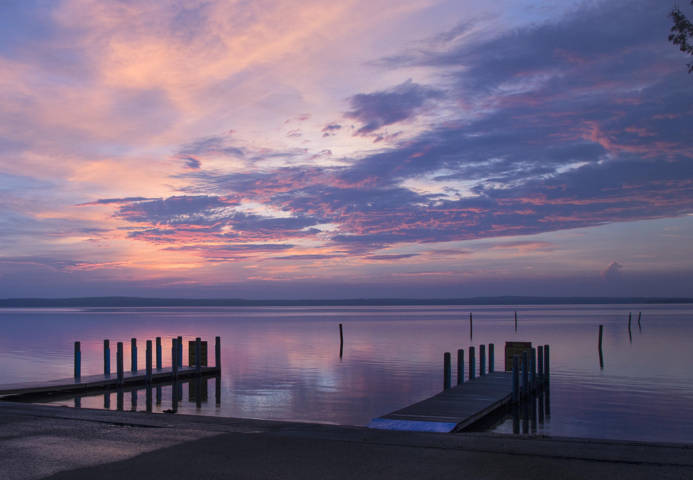 A few piers in Higgins Lake at dusk