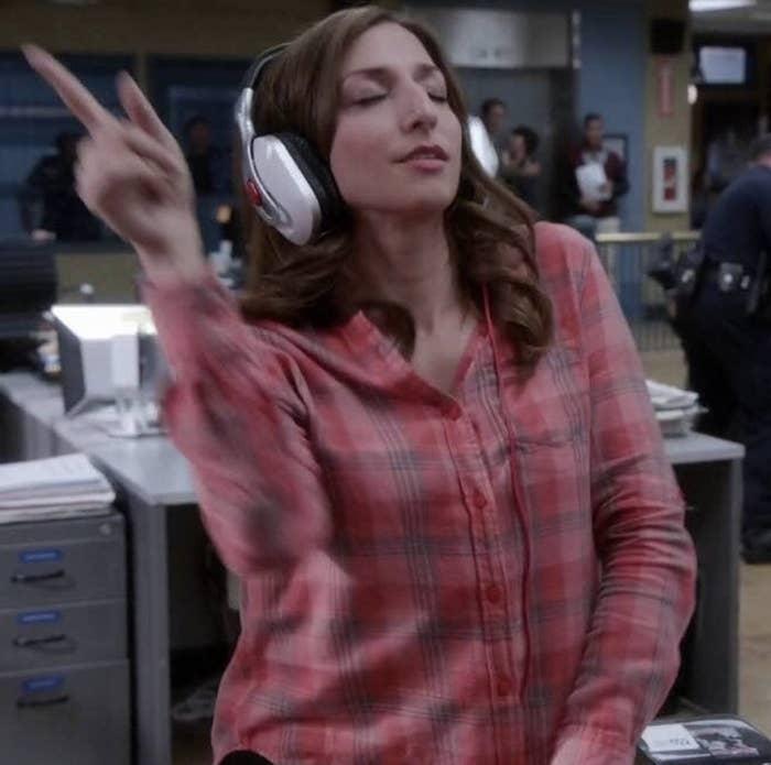 "Gina from ""Brooklyn Nine-Nine"" dancing to music with headphones on"