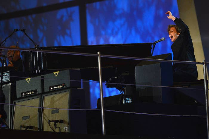 Paul McCartney plays piano at the opening ceremony
