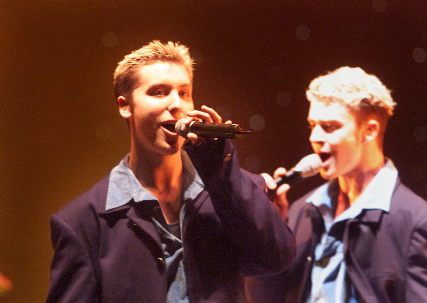 Lance Bass and Justin Timberlake singing onstage together