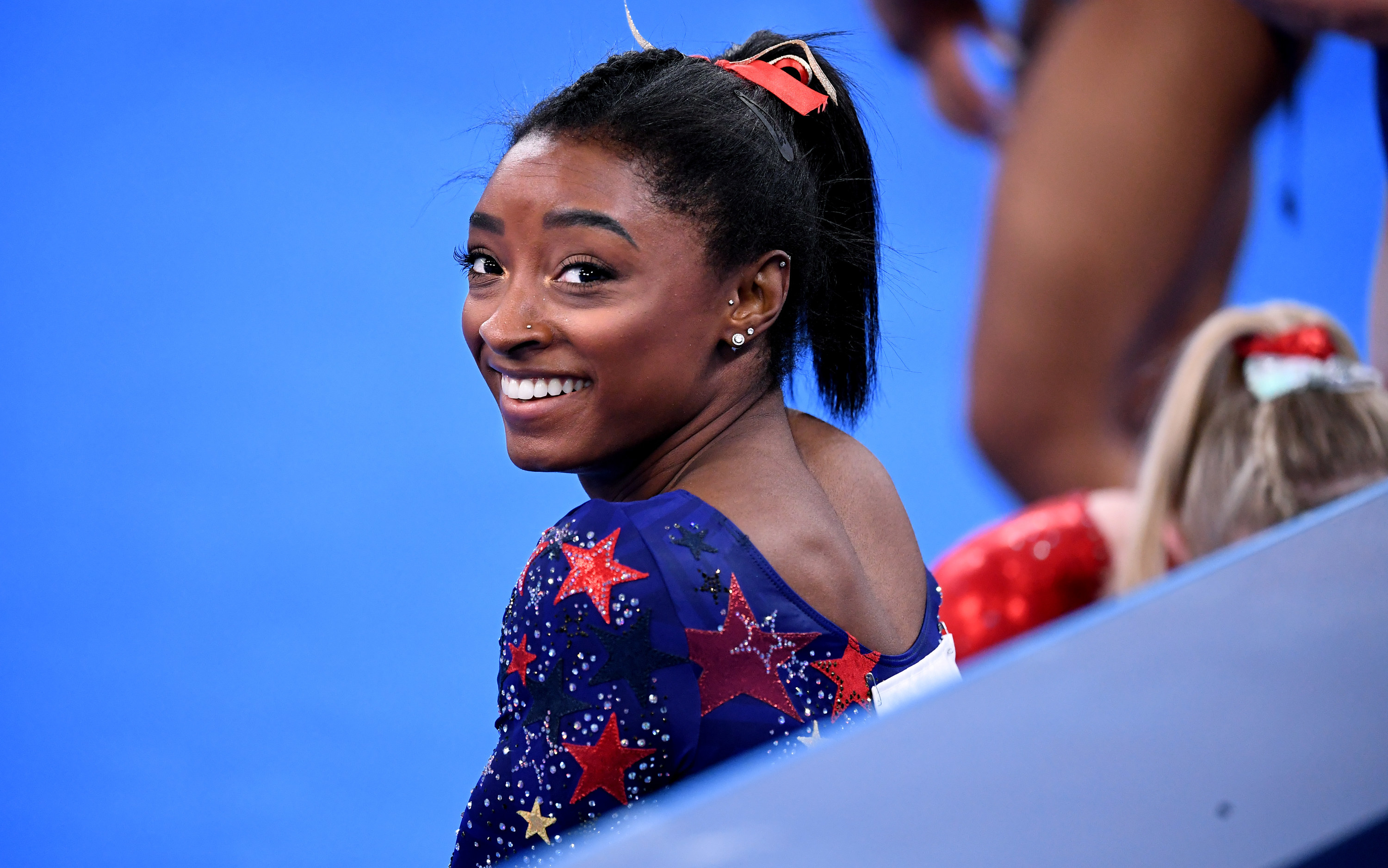 Simone Biles is pictured smiling during the women's qualifying rounds at the 2020 Tokyo Olympics