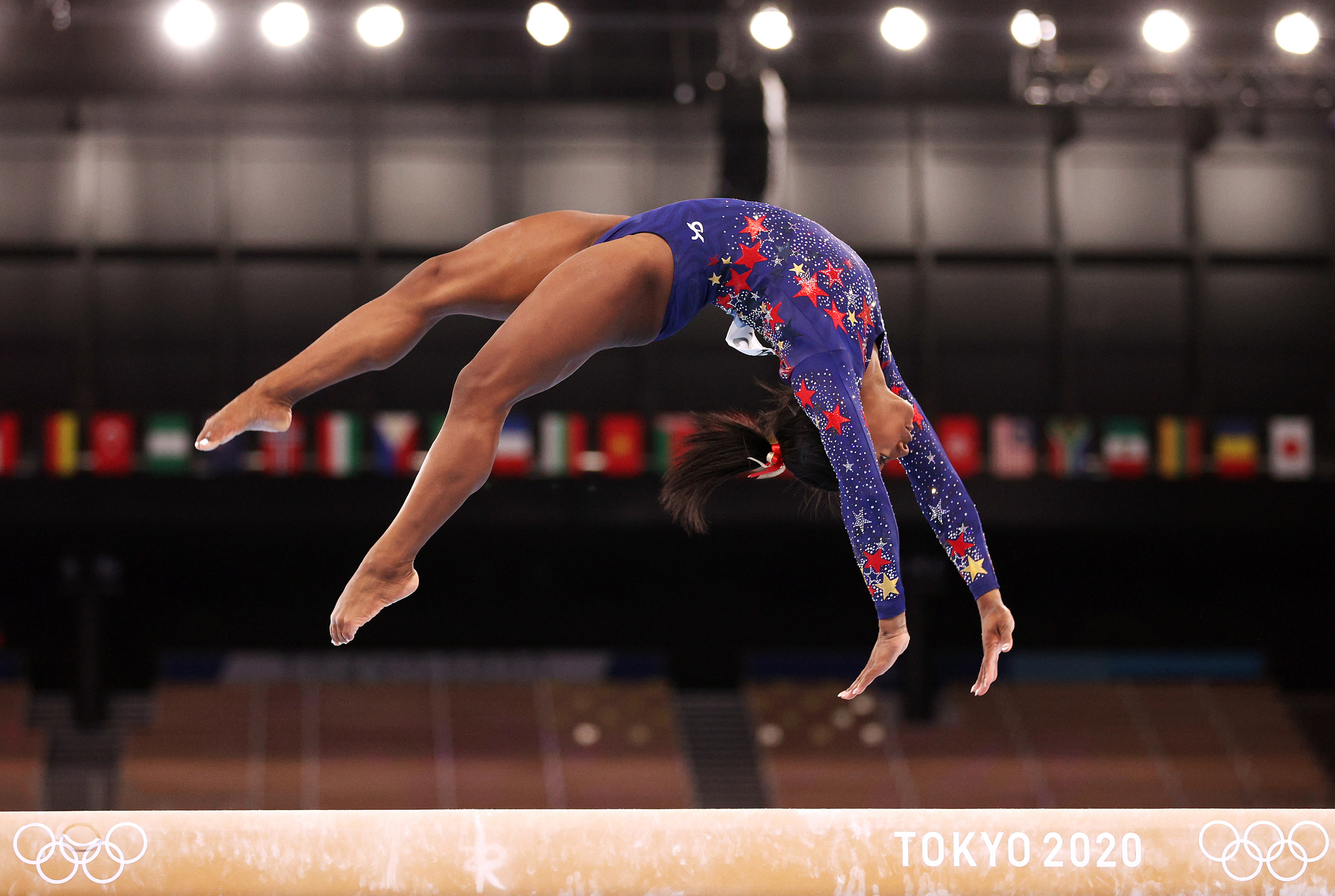 Simone Biles competes on balance beam during gymnastics qualification rounds at the 2020 Tokyo Olympic Games
