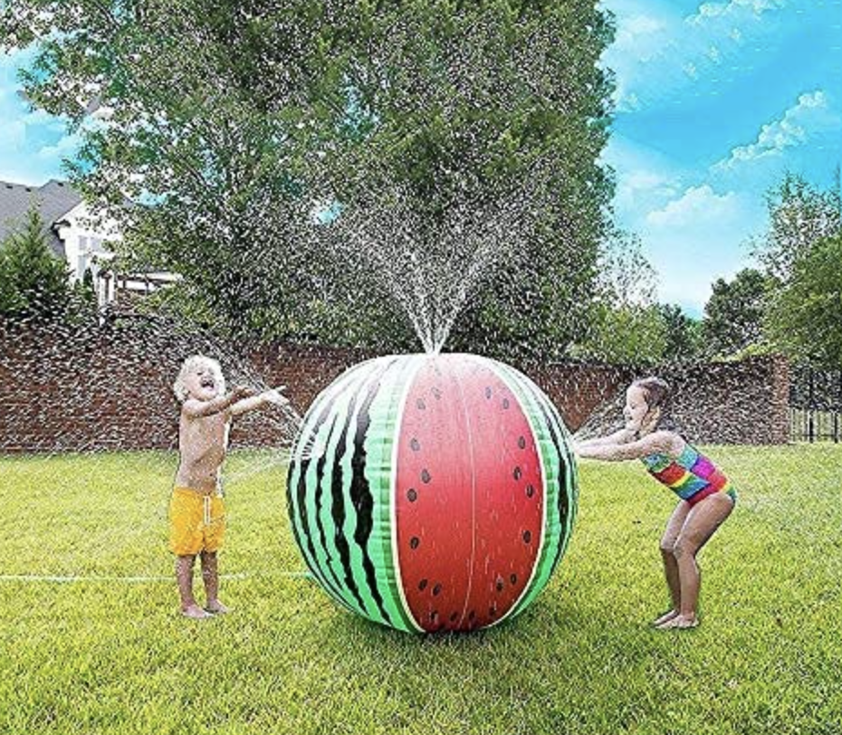 kids playing with watermelon sprinkler
