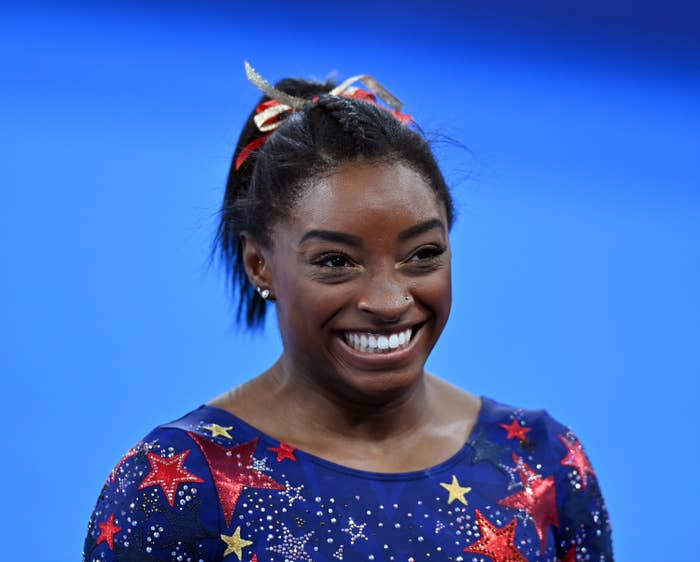 Simone Biles is pictured smiling during the artistic gymnastic women's qualifying rounds at the Tokyo 2020 Olympic Games