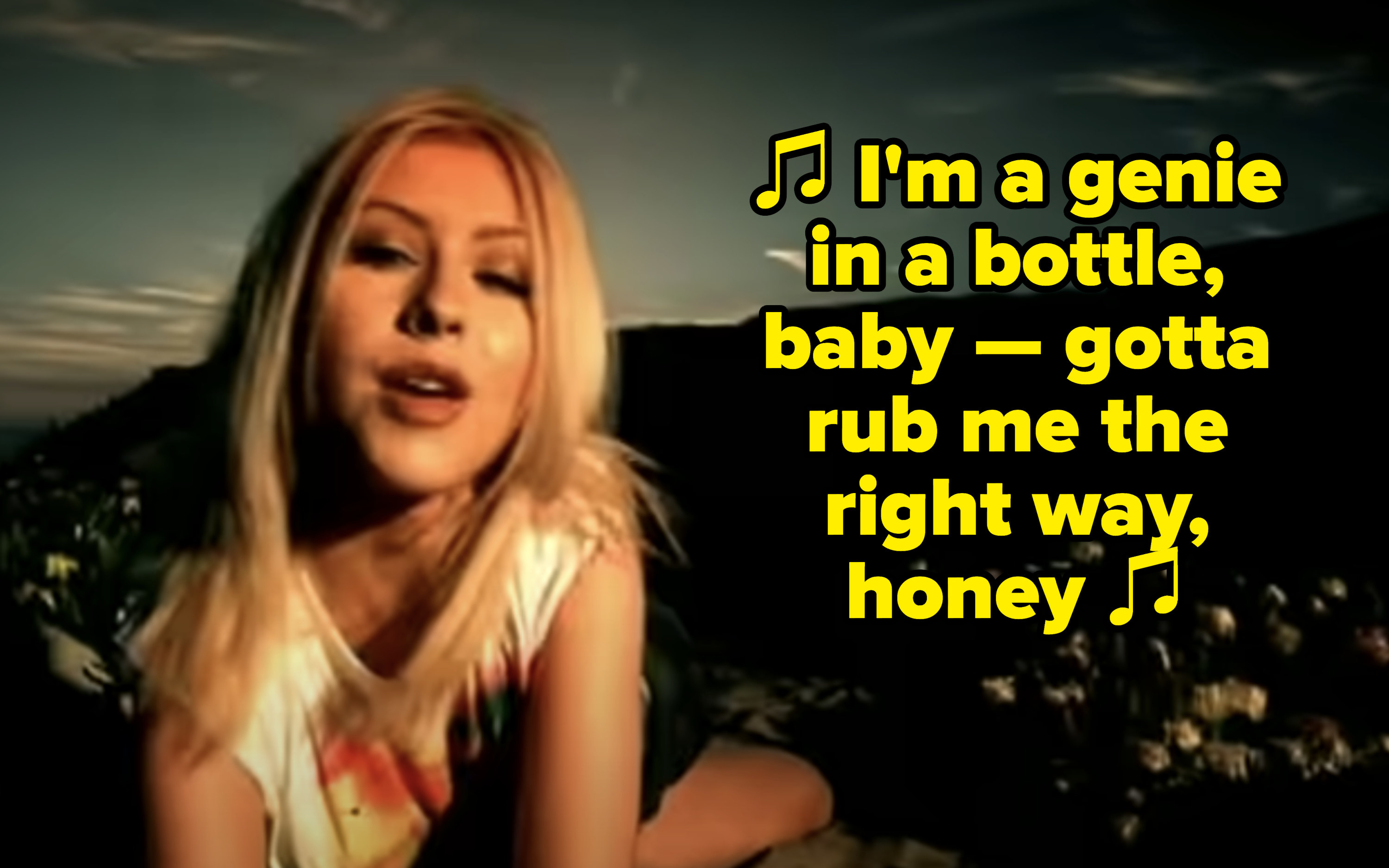 """Christina Aguilera singing: """"I'm a genie in a bottle, baby — gotta rub me the right way, honey"""""""