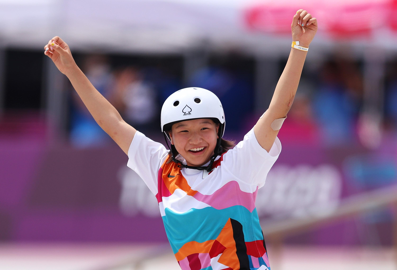 Momiji Nishiya raising arms and smiling