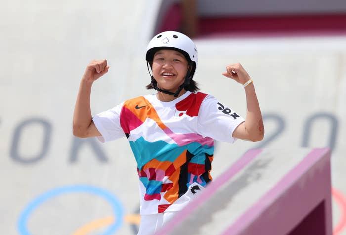 Momiji Nishiya flexing on skateboard
