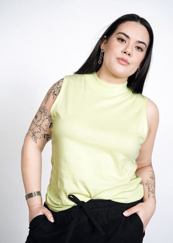 a model wearing the mock neck top in pistachio color