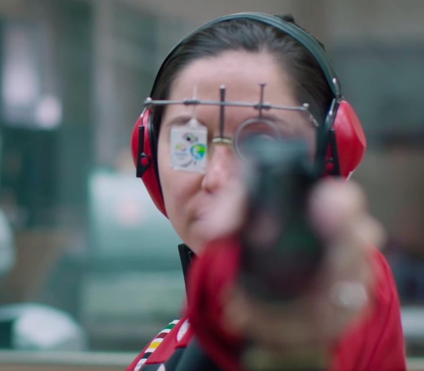 Lynda aims her pistol