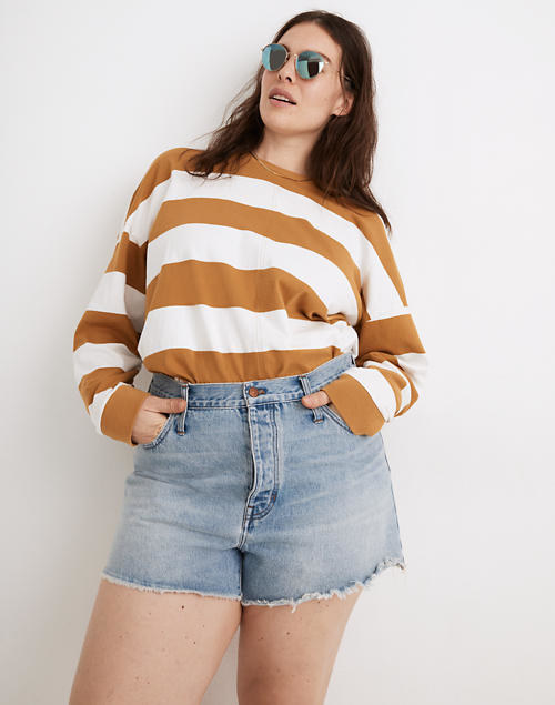 a model wearing the shorts with a striped shirt
