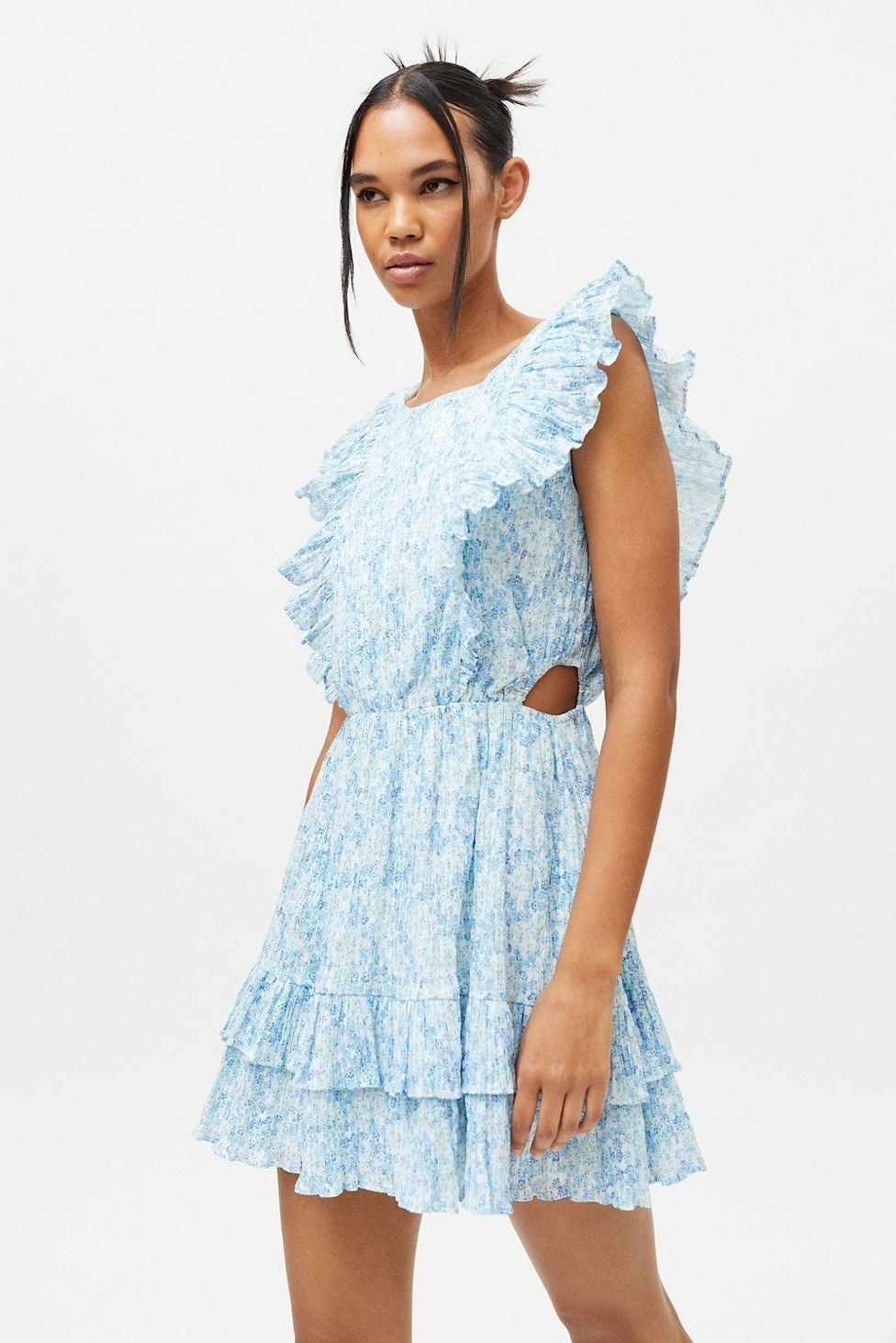 a model wearing the blue floral MINKPINK Zahari ruffle sleeve mini dress