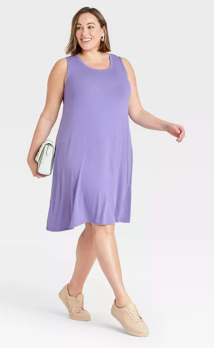 a model wearing the dress in violet
