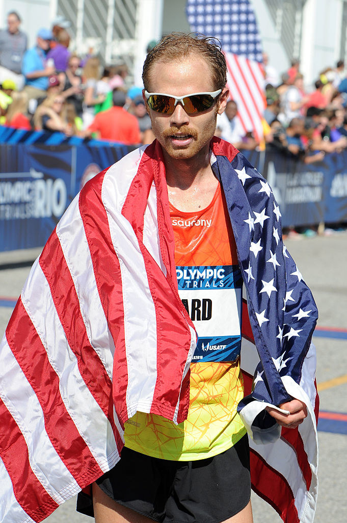 Jared wears an American flag around his shoulders after qualifying for the Rio Games