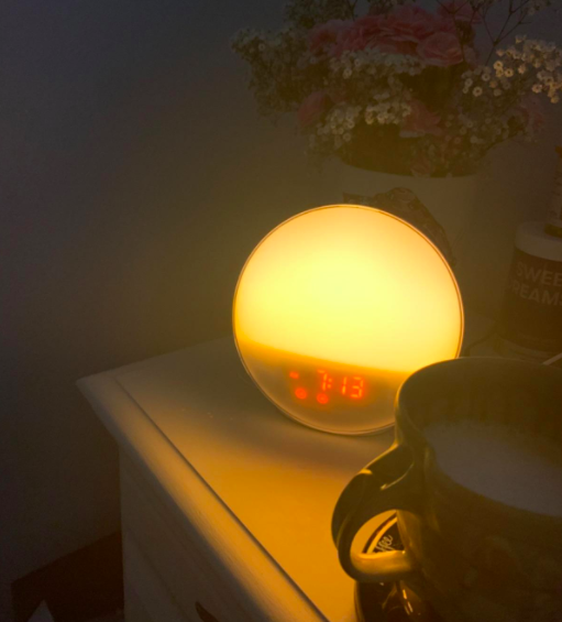 A customer review photo of the alarm clock on their nightstand