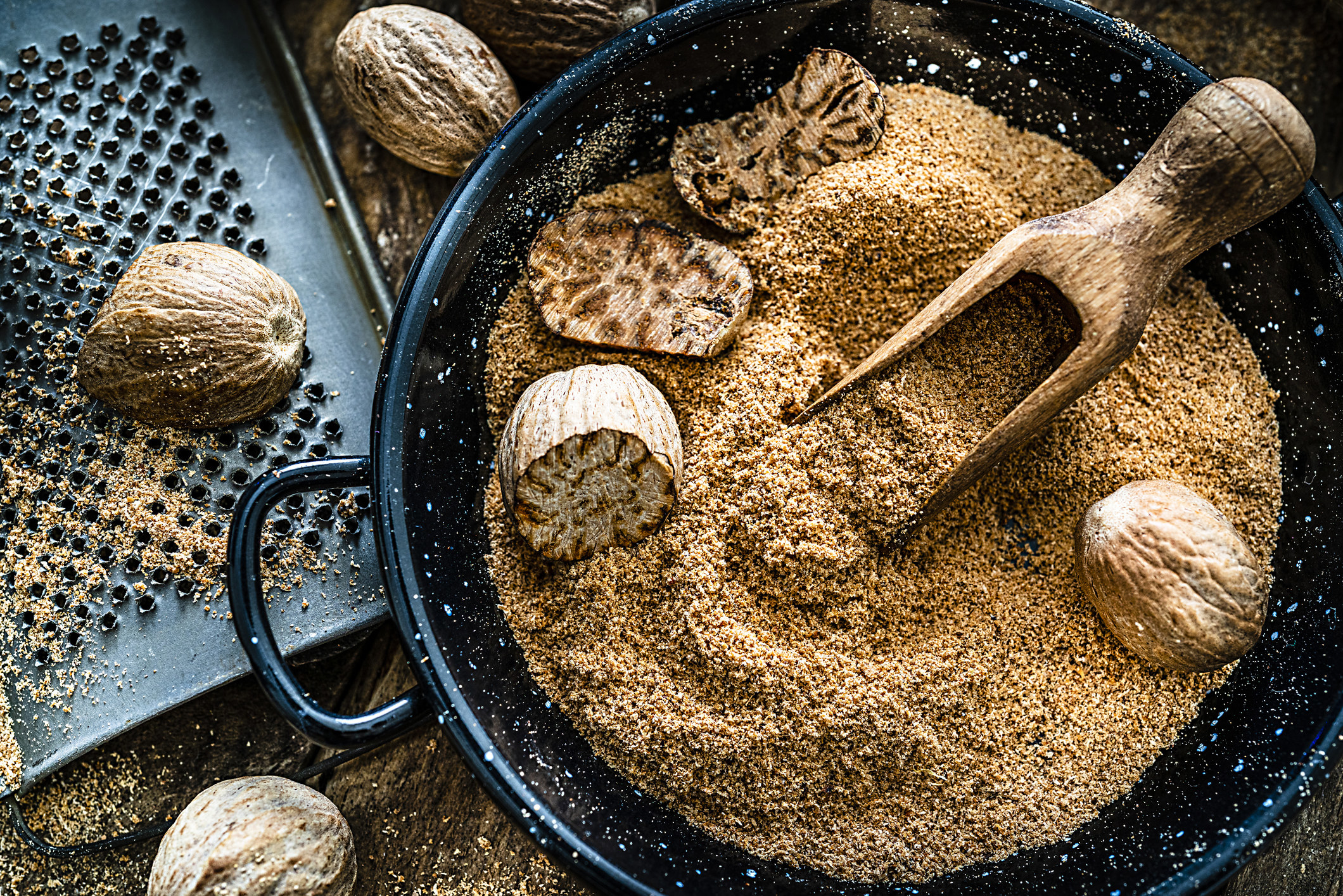 bowl of ground nutmeg and nuts