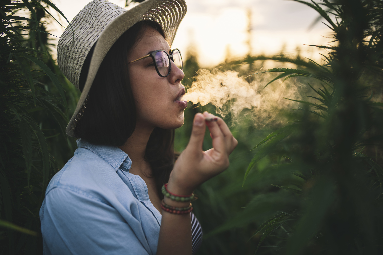 An image of a woman smoking cannabis