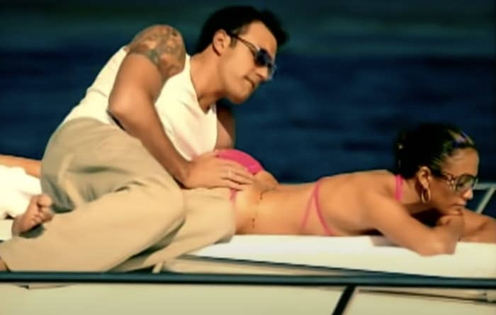 Ben puts his hand on Jen's booty while they lay on a yacht in the music video