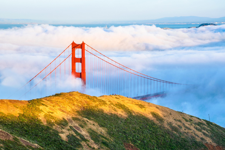 Fog flowing across the Golden Gate Bridge as seen from the Marin Headlands in San Francisco, California.