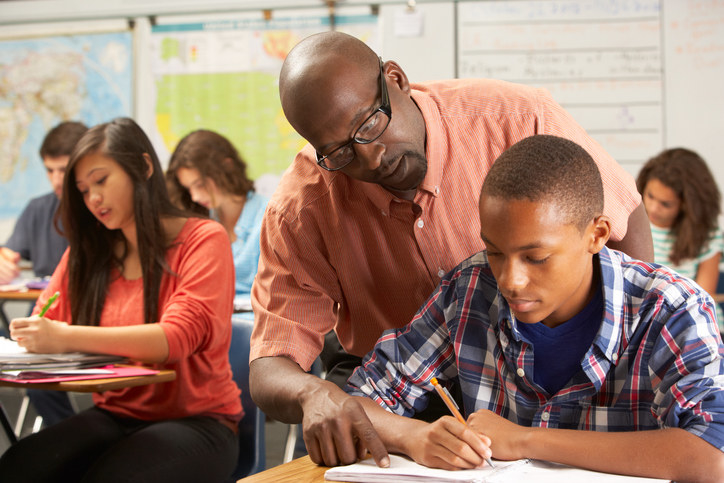 Teacher helping a student with a problem