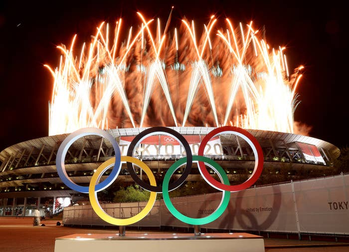 The Olympic rings sit outside the stadium in Tokyo in the middle of a fireworks display