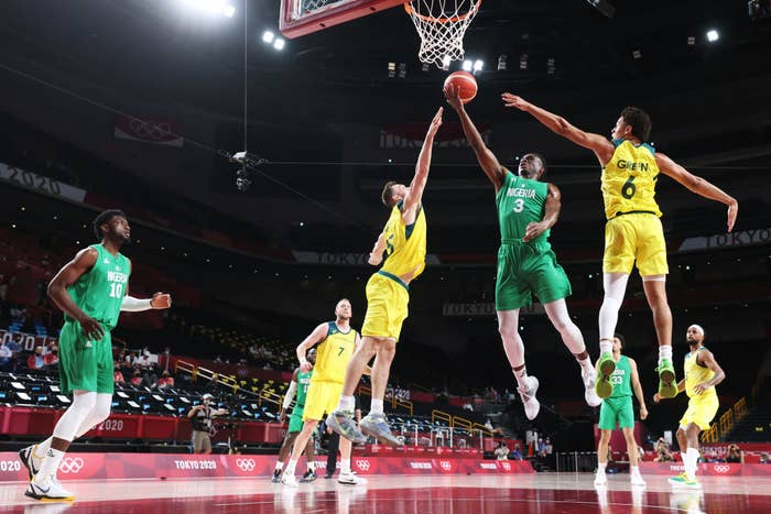 Caleb Agada of Team Nigeria attempts to score a goal against Team Australia in a basketball match during the Olympics