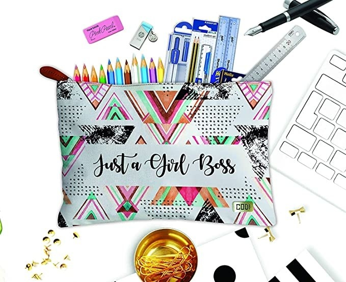 """A colourful pouch with the words """"Just a Girl Boss"""" on it"""