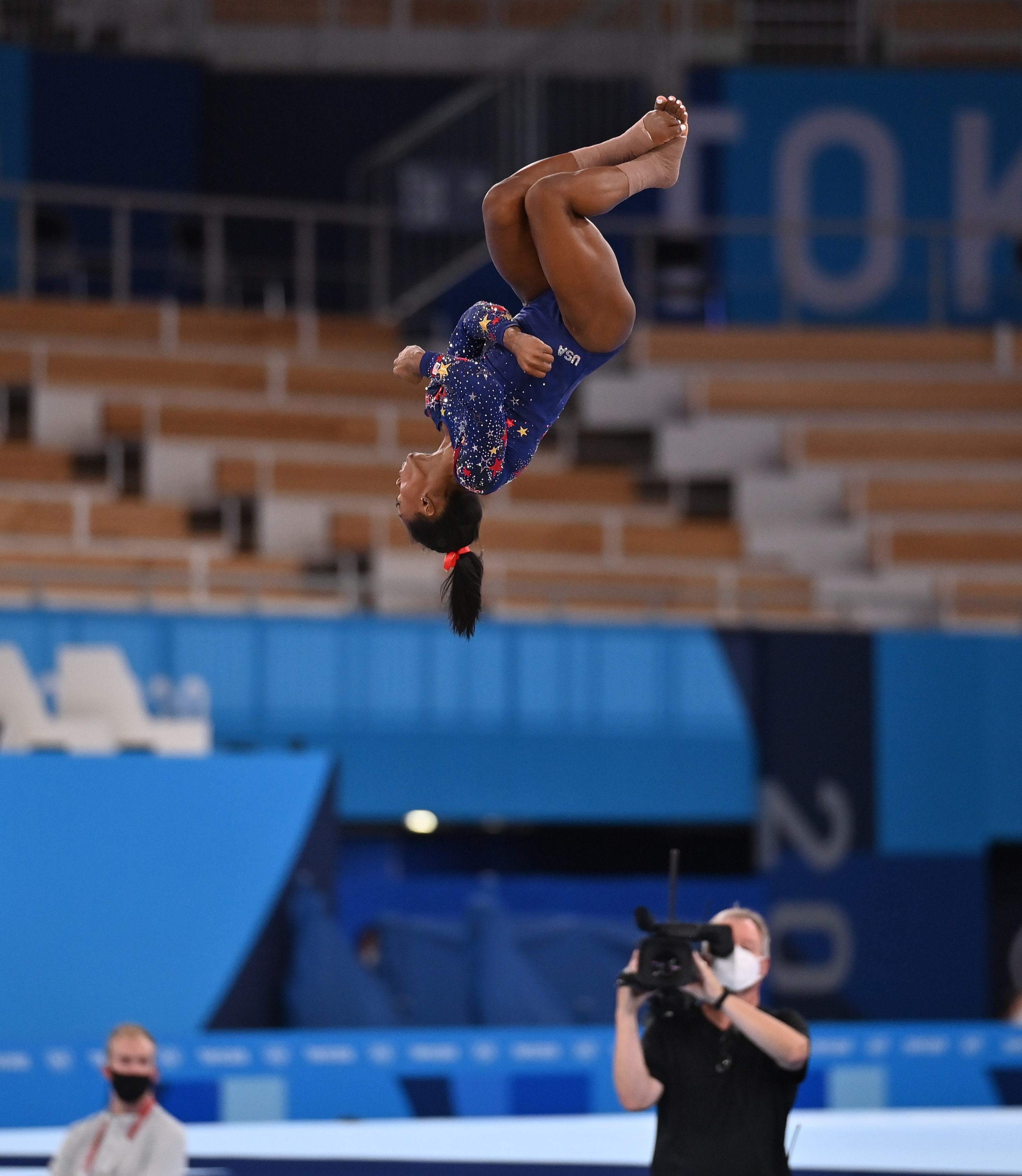 Simone is airborne and upside down