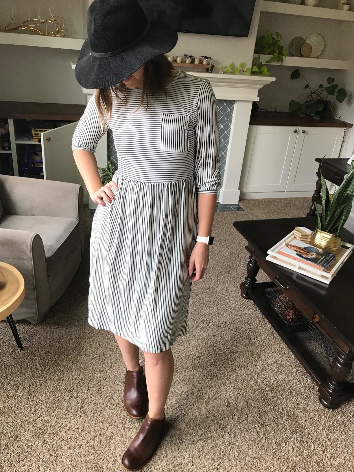 image of reviewer wearing the striped charcoal balloon sleeve shirt dress