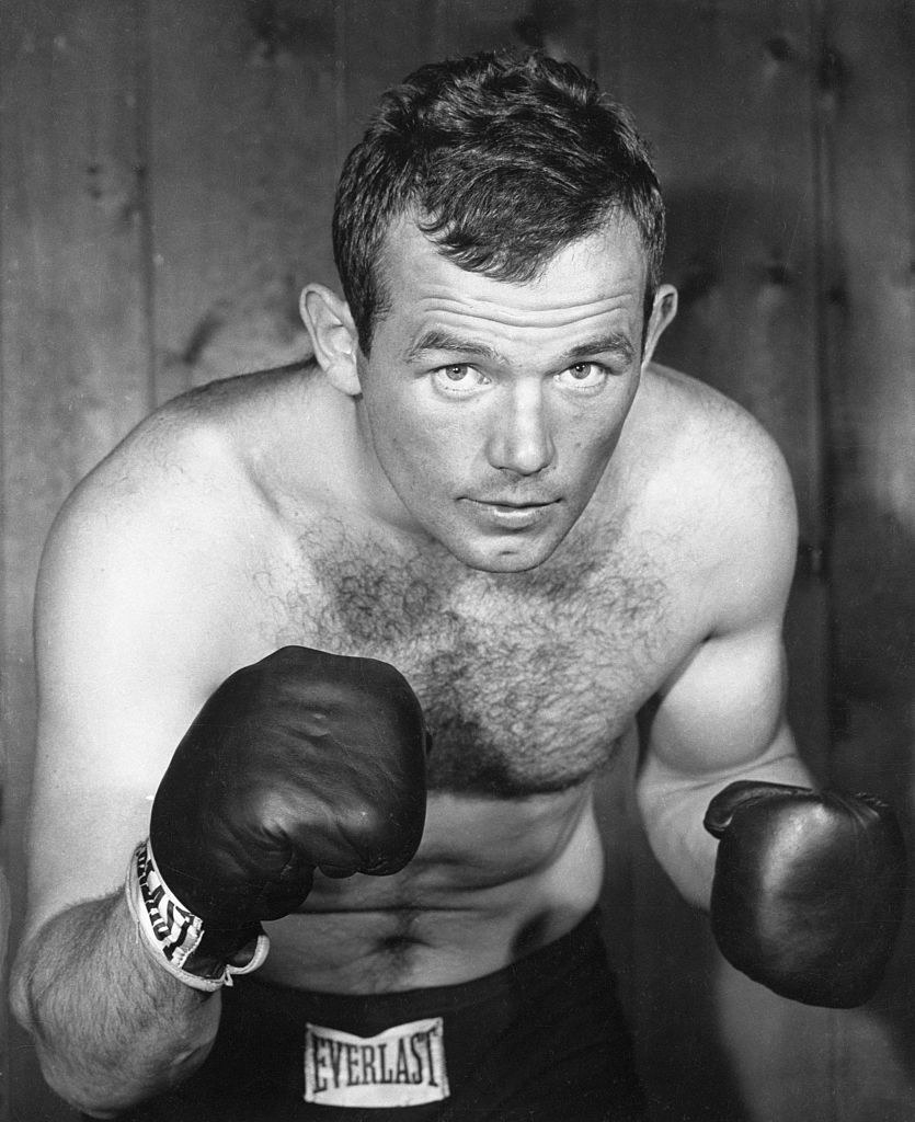 Ingemar Johansson in a closeup pose, waist-up and he has his boxing gloves and trunks on