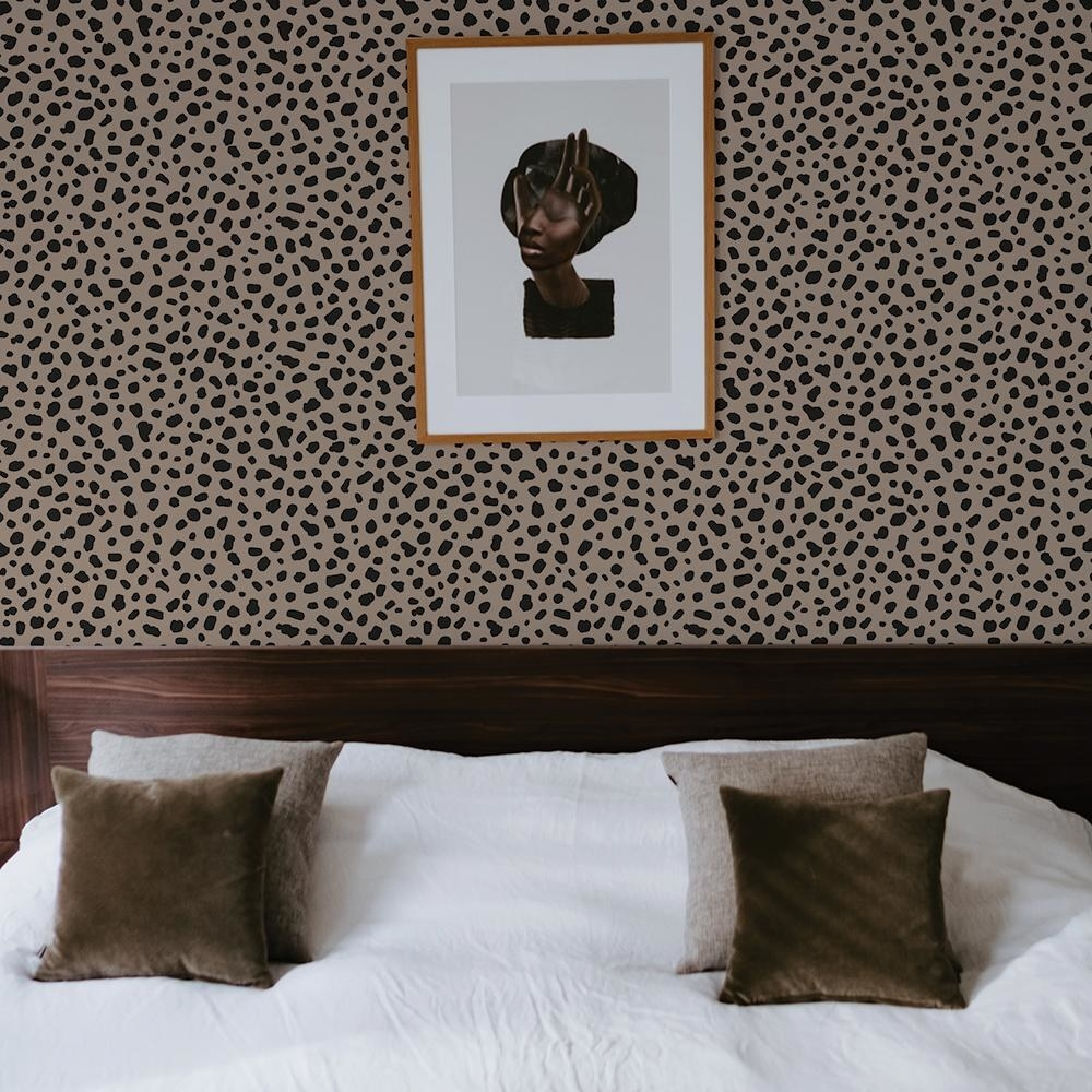 Leopard print wallpaper in a bedroom