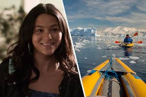 A close up of Izzie as she smiles brightly and two kayaks float through an icy ocean