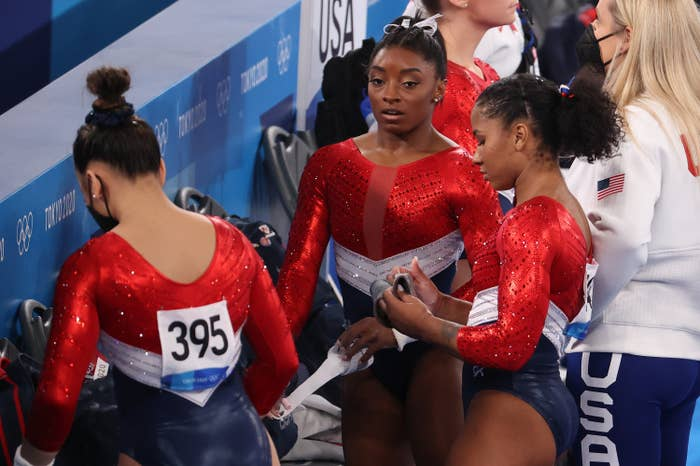 Simone standing with her teammates