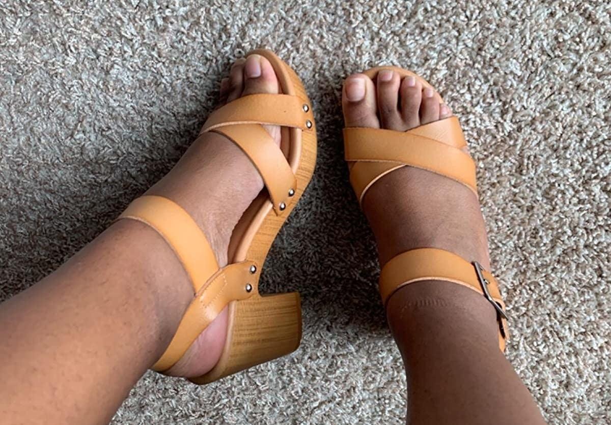 reviewer wearing the tan faux wood heels
