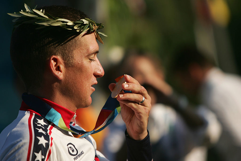Tyler Hamilton holding his gold medal at the 2004 olympics