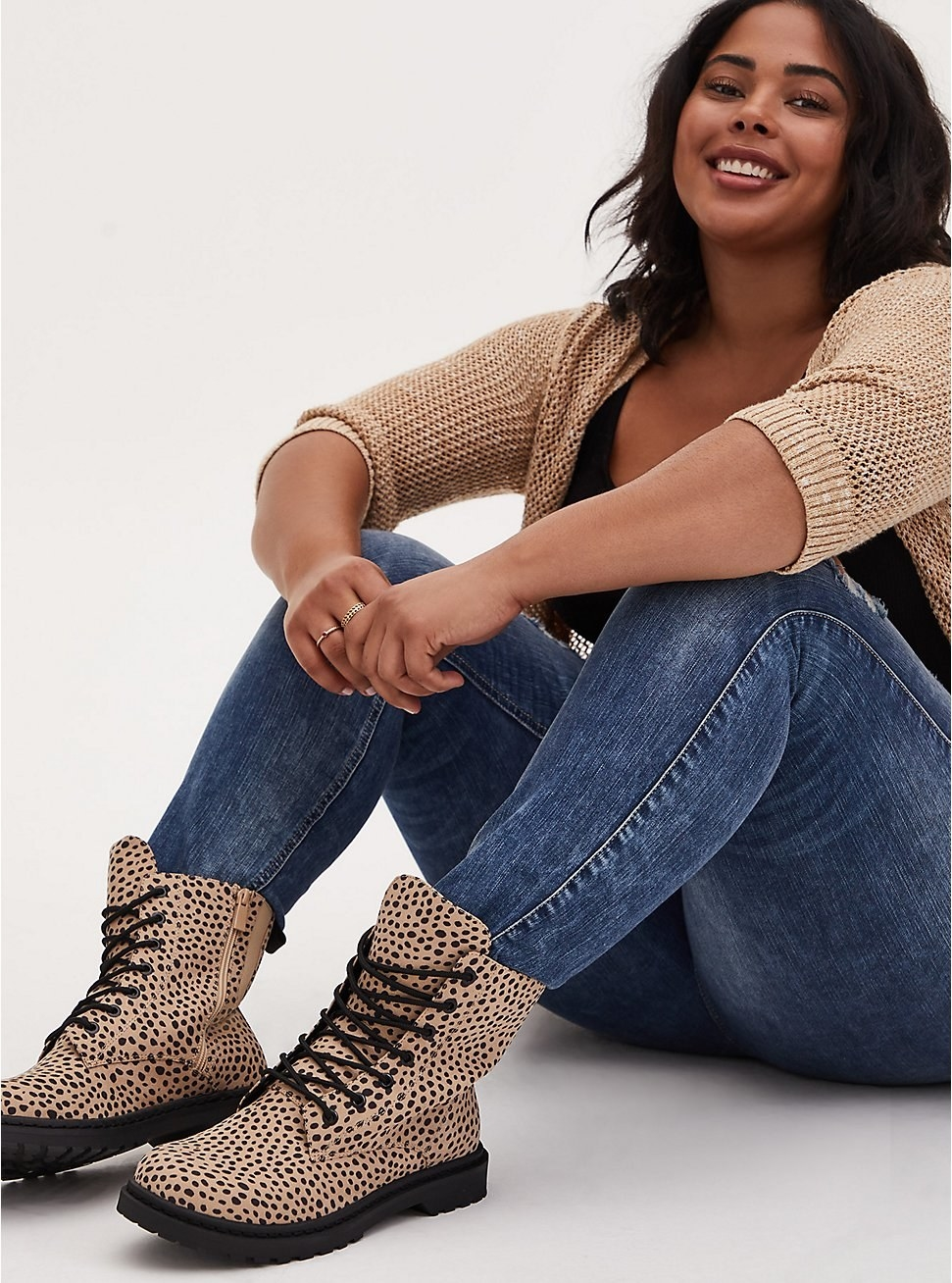 model wearing the leopard print ankle lace up boots
