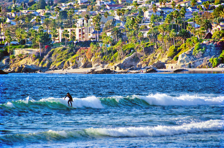 Person surfs waves at Laguna Beach