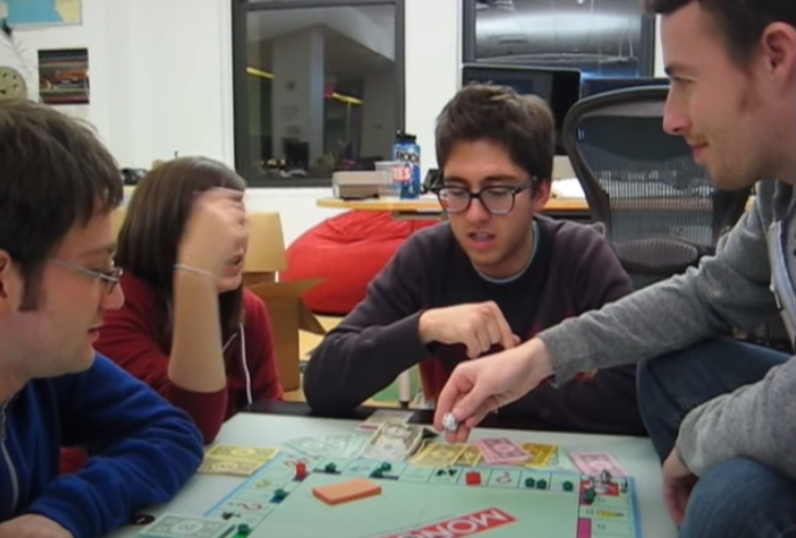 Screenshot of Jake and Amir playing Monopoly with two other people