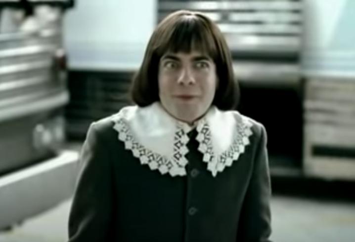 A man dressed as Tom Thumb