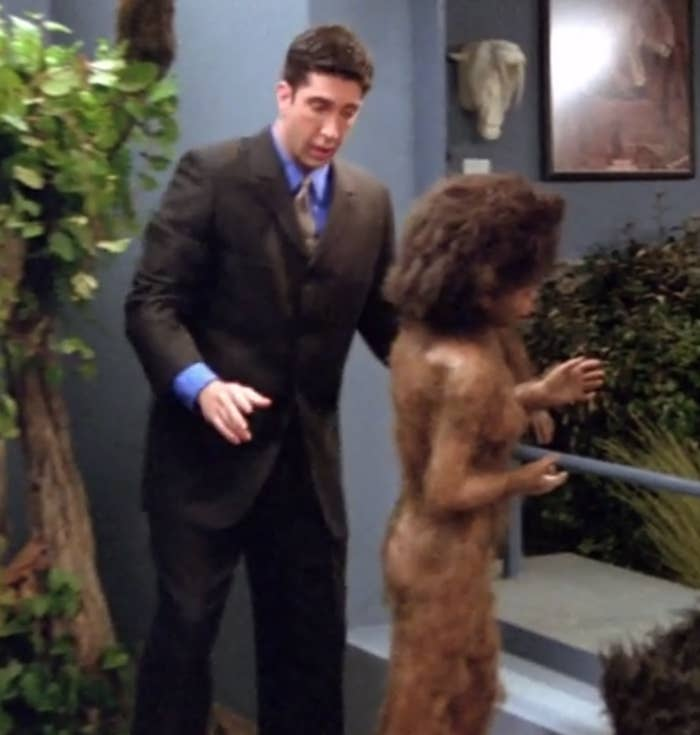 Ross adjusts a statue of a prehistoric male