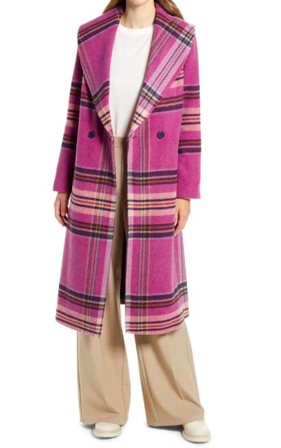 A model wearing the plaid coat